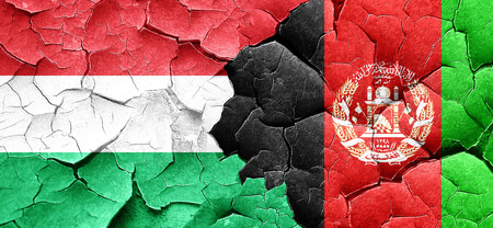 afghan: Hungary flag with afghanistan flag on a grunge cracked wall