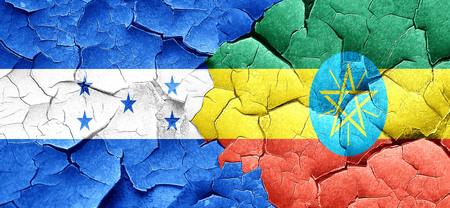 bandera honduras: bandera de Honduras con la bandera de Etiop�a en una pared agrietada grunge
