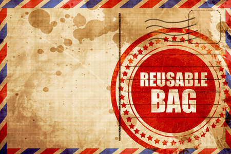 reusable: reusable bag, red grunge stamp on an airmail background