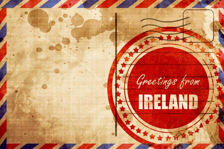 air travel: Greetings from ireland card with some soft highlights, red grunge stamp on an airmail background