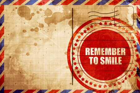acordarse: remember to smile, red grunge stamp on an airmail background Foto de archivo