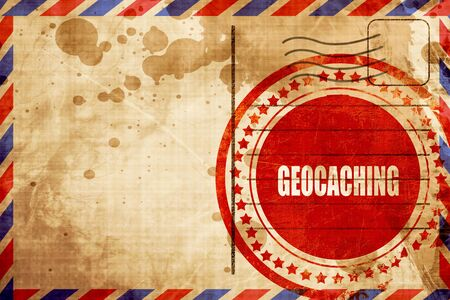 caching: geocaching sign background with some soft smooth lines, red grunge stamp on an airmail background Stock Photo
