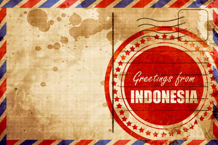 air travel: Greetings from indonesia card with some soft highlights, red grunge stamp on an airmail background Stock Photo