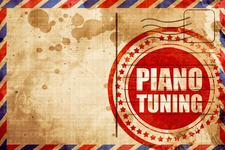 airmail: piano tuning, red grunge stamp on an airmail background Stock Photo