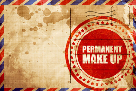 permanent: permanent make up, red grunge stamp on an airmail background