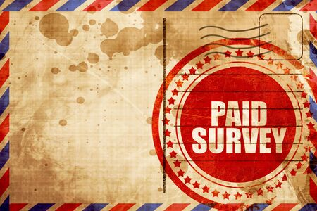 paid stamp: paid survey, red grunge stamp on an airmail background Stock Photo
