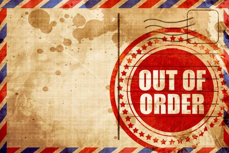 out of order: out of order, red grunge stamp on an airmail background