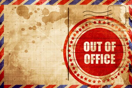 days gone by: out of office, red grunge stamp on an airmail background