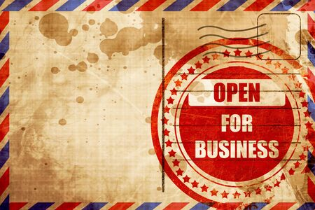 business letters: Open for business sign with some soft highlights, red grunge stamp on an airmail background