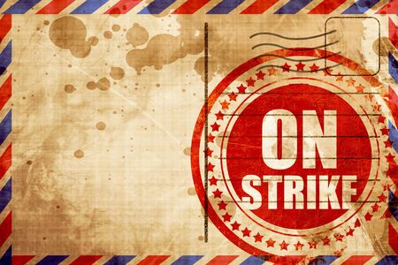 clash: on strike, red grunge stamp on an airmail background