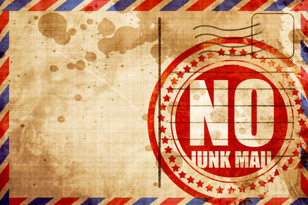 junk mail: no junk mail, red grunge stamp on an airmail background