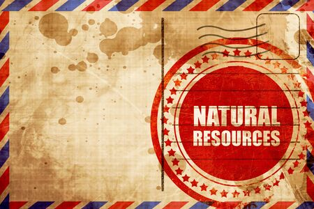 airmail: natural resources, red grunge stamp on an airmail background Stock Photo