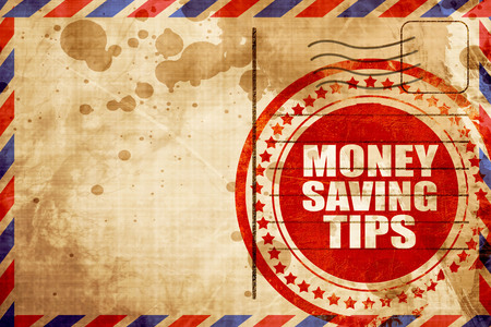 saving tips: money saving tips, red grunge stamp on an airmail background