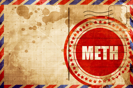 meth: meth, red grunge stamp on an airmail background