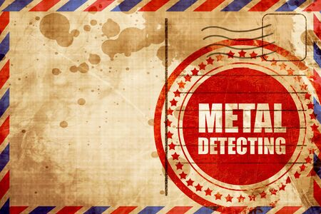 detecting: metal detecting, red grunge stamp on an airmail background