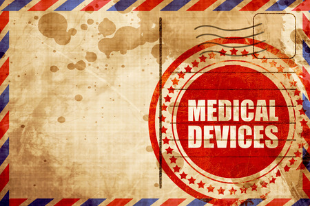 airmail: medical devices, red grunge stamp on an airmail background