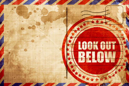 look out: look out below, red grunge stamp on an airmail background Stock Photo