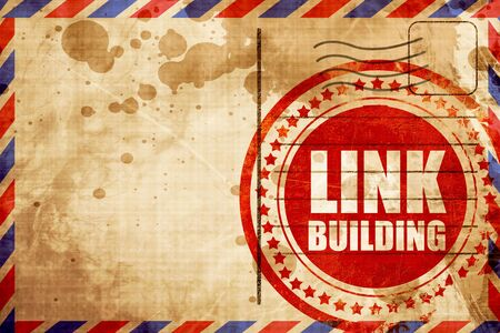link building: link building, red grunge stamp on an airmail background