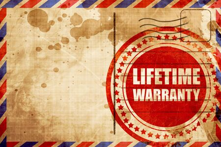 airmail stamp: lifetime warranty, red grunge stamp on an airmail background Stock Photo