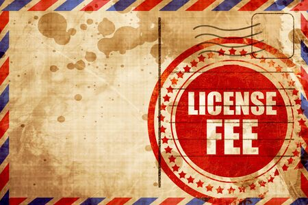hidden costs: license fee, red grunge stamp on an airmail background