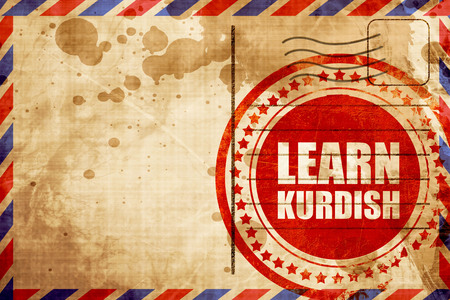 autodidact: learn kurdish, red grunge stamp on an airmail background
