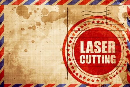 lasercutting: laser cutting, red grunge stamp on an airmail background
