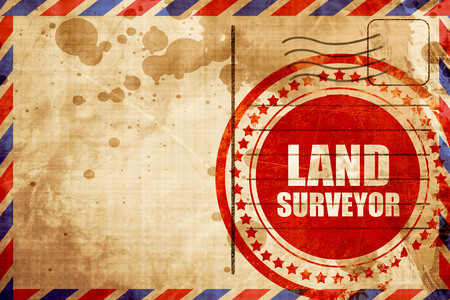 geodesy: land surveyor, red grunge stamp on an airmail background Stock Photo