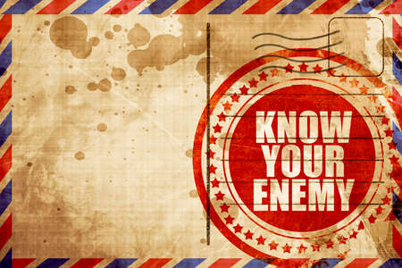 enemy: know your enemy, red grunge stamp on an airmail background Stock Photo