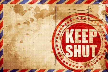 shut: keep shut, red grunge stamp on an airmail background