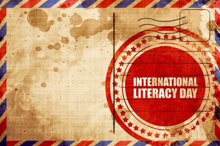 literacy: international literacy day, red grunge stamp on an airmail background