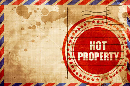desirable: hot property, red grunge stamp on an airmail background