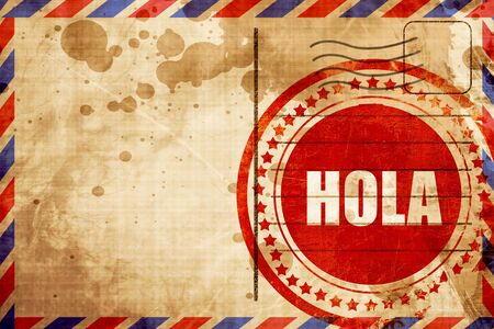 airmail: hola, red grunge stamp on an airmail background Stock Photo
