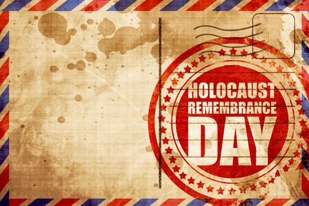 holocaust: holocaust remembrance day, red grunge stamp on an airmail background