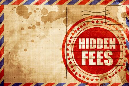 hidden costs: hidden fees, red grunge stamp on an airmail background