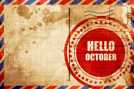 airmail stamp: hello october, red grunge stamp on an airmail background Stock Photo