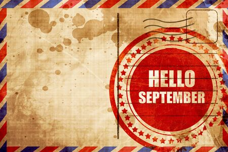 hello september, red grunge stamp on an airmail background