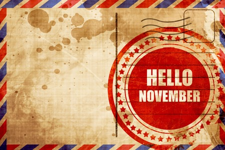 airmail stamp: hello november, red grunge stamp on an airmail background