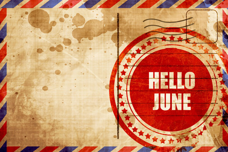 airmail stamp: hello june, red grunge stamp on an airmail background
