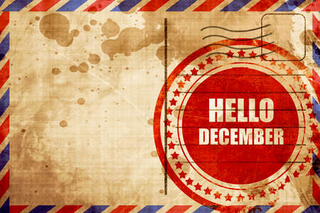 airmail stamp: hello december, red grunge stamp on an airmail background