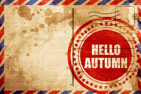 airmail stamp: hello autumn, red grunge stamp on an airmail background
