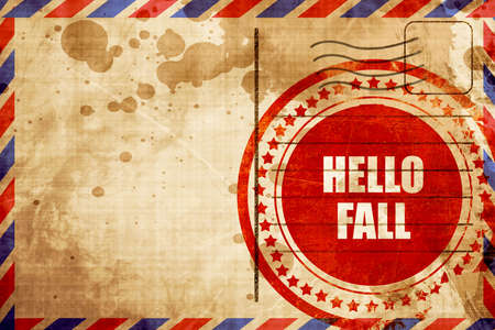 airmail stamp: hello fall, red grunge stamp on an airmail background Stock Photo