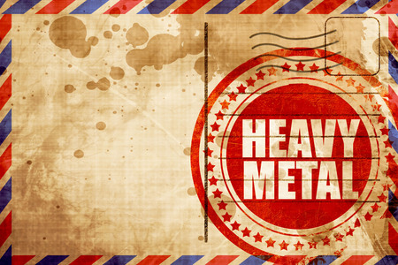 heavy metal music: heavy metal music, red grunge stamp on an airmail background