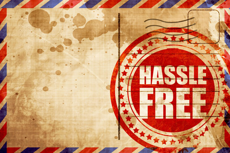 hassle: hassle free, red grunge stamp on an airmail background Stock Photo