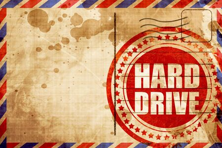 harddrive: harddrive, red grunge stamp on an airmail background Stock Photo