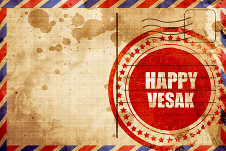 airmail stamp: happy vesak, red grunge stamp on an airmail background Stock Photo