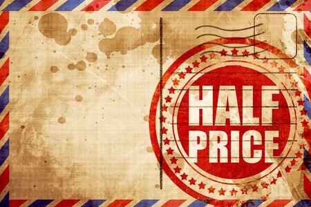 half price: half price, red grunge stamp on an airmail background
