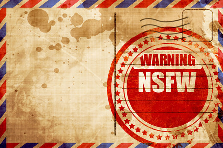 Not safe for work sign with some vivid colors, red grunge stamp on an airmail background Фото со стока