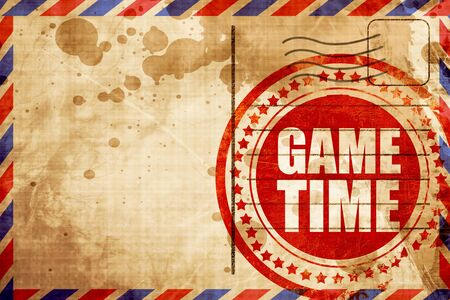 game time: game time, red grunge stamp on an airmail background