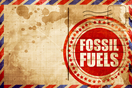 fossil fuels: fossil fuels, red grunge stamp on an airmail background