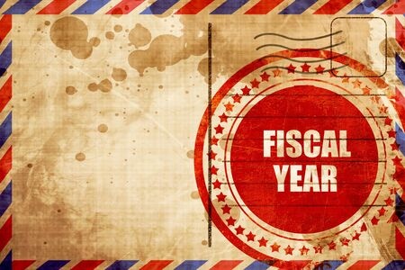 fiscal: fiscal year, red grunge stamp on an airmail background